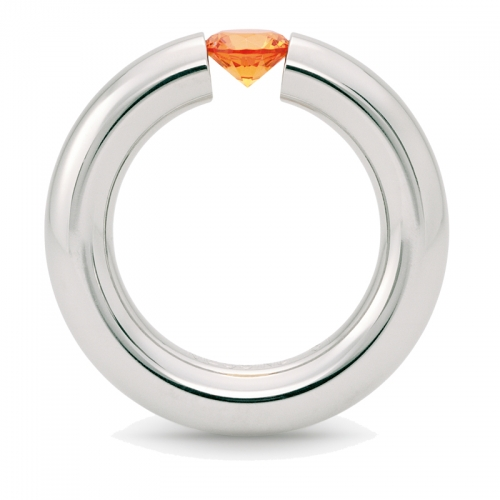 Niessing Spannring, der wohl begehrteste Ring, in Edelstahl mit einer leuchtenden Synthese. Wagen Sie den Spagat.