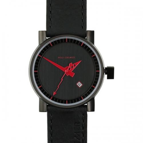 Rolf Cremer. Design in Uhren. Tower Automatic. Damen-und Herrenuhr inrunder Form, in schwarz mit kontrastreichem rot.