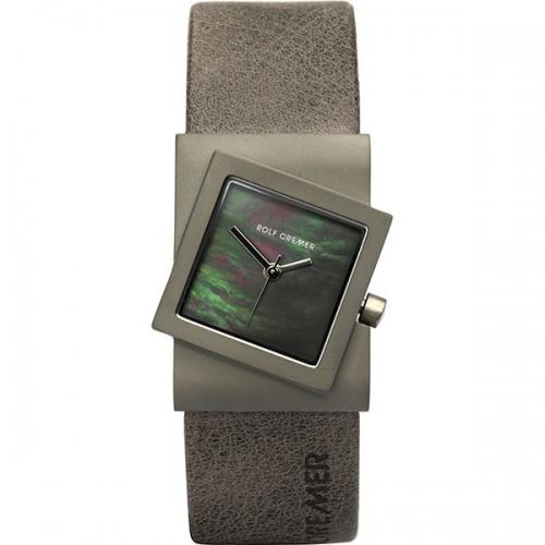 Rolf Cremer. Design in Uhren. Die Turn. Damenuhr in schräger Form. Schlammfarben
